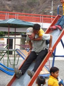 A volunteer playing with students